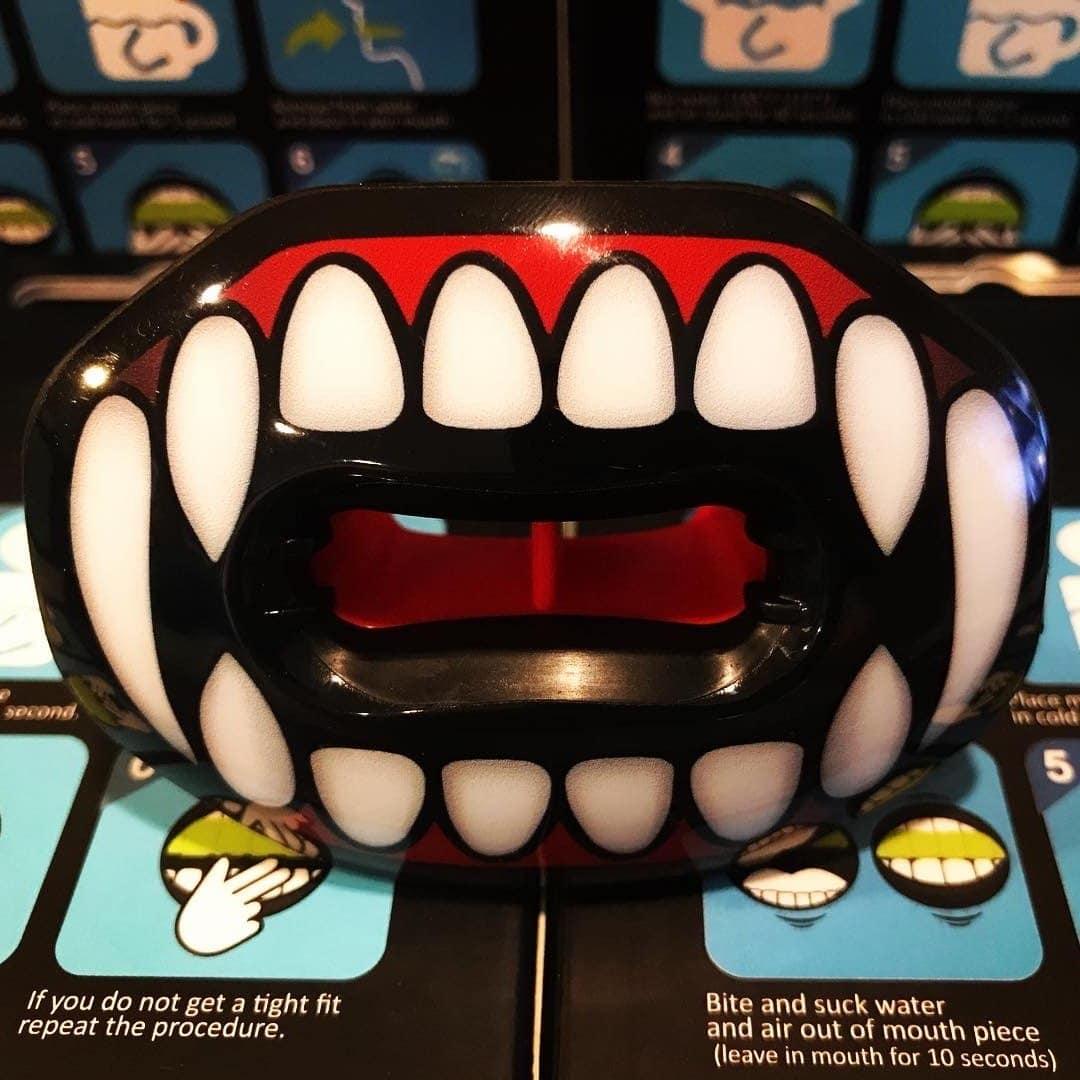 vampire fangs football lip guard